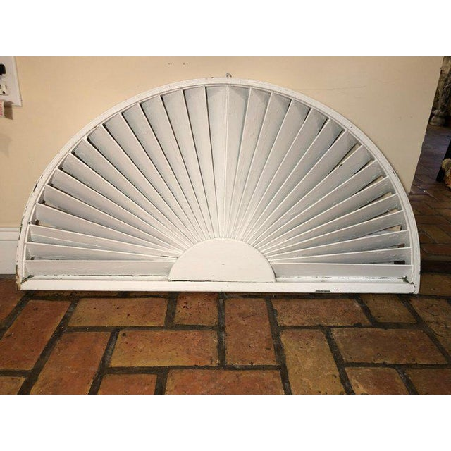 Antique architectural demilune sunburst window fragment. Half mooned fan like shape. Painted white on one side and...