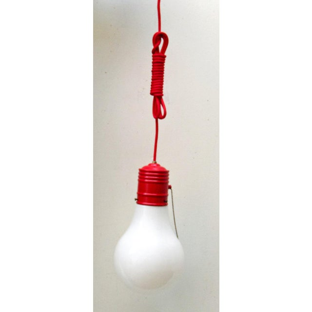 A fun piece of Pop Art in the form of a pendant light by Ingo Maurer. This oversized lightbulb fixture has been...