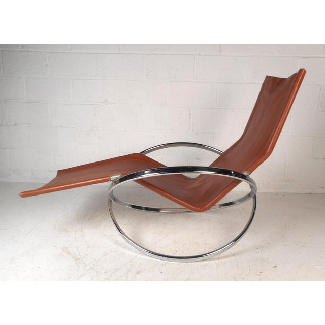 This gorgeous rocking chaise lounge is sure to make a statement in any seating arrangement. Italian design from the 1960s,...