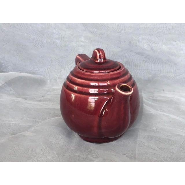 The perfect size for brewing one mug-size cup of tea, this small vintage USA pottery teapot is also decorative and could...