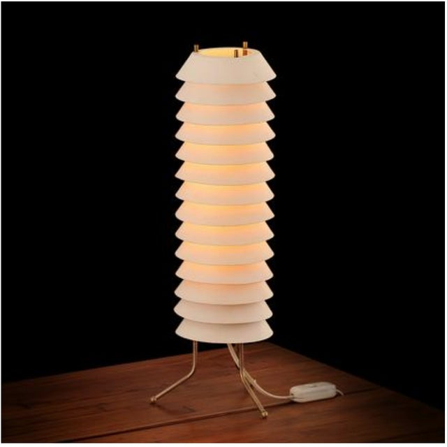 A nice example of Tapiovaara's rare Maija Mehiläinen--Maya the Bee--table lamp. The form of this large lamp is elegant and...