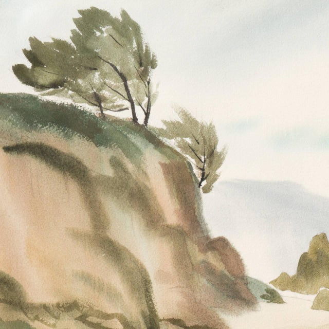A substantial mid-century Impressionist-style watercolor on Arches paper showing a misty view of a secluded Big Sur rocky...