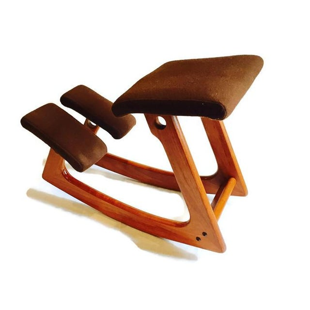 Mid-century teak chair / stool / kneeling rocking chair style, by Norway's infamous Balans! Sleek modern lines, rocks, and...
