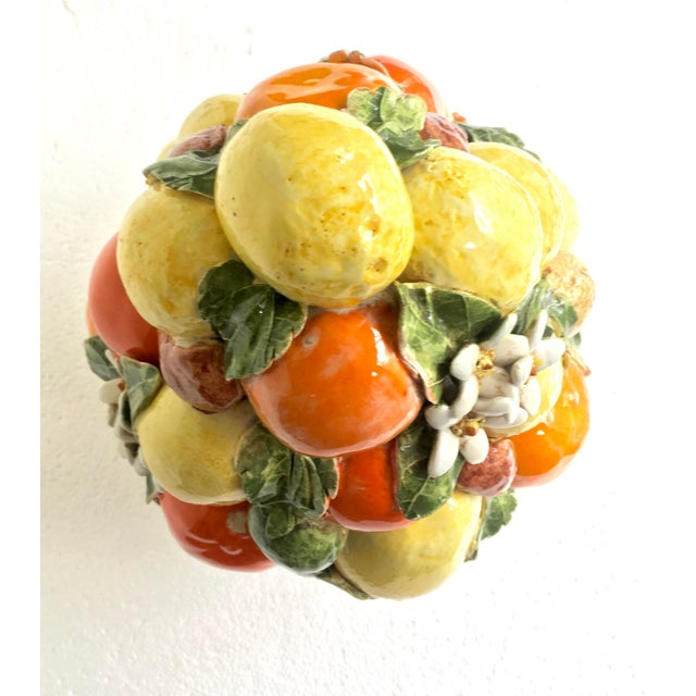 Beautiful Italian Ceramic, hand painted in the majolica style, glazed Lemon, Orange, Daisy, Fig, Walnut Topiary. It is...
