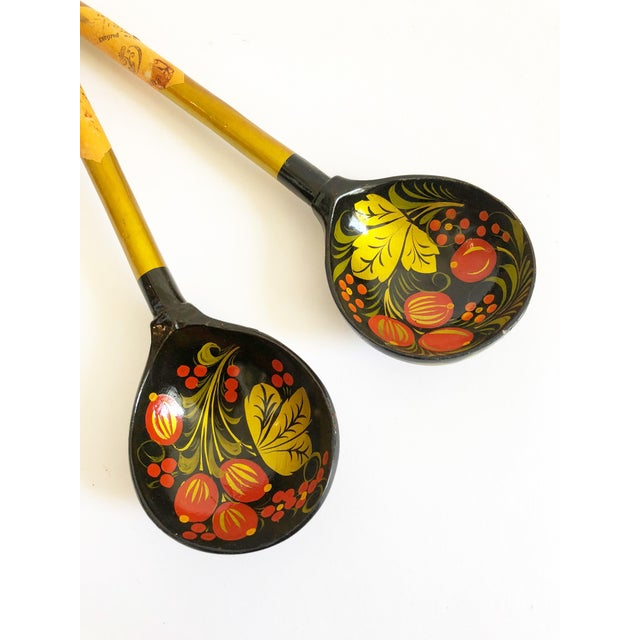 A beautiful set of vintage Russian laquerware salad servers. Made of wood with a colorful painted and lacquered floral...