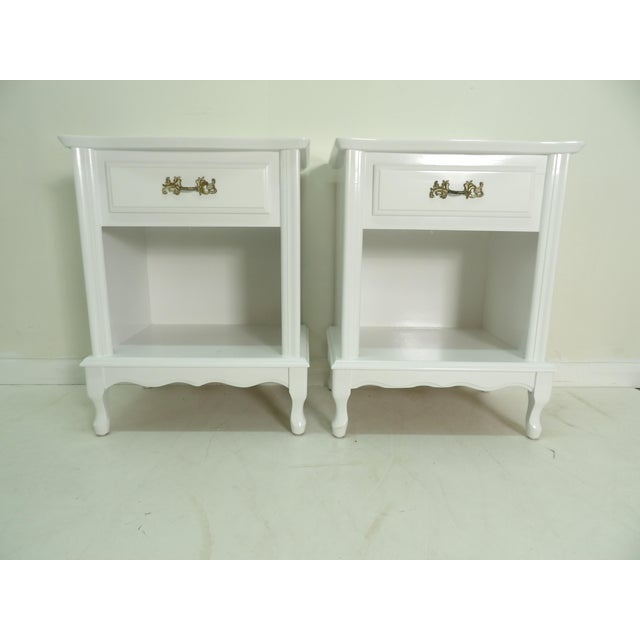 In a clean and crisp new white lacquer finish are this pair of nightstands. These feature a single top drawer as well as...