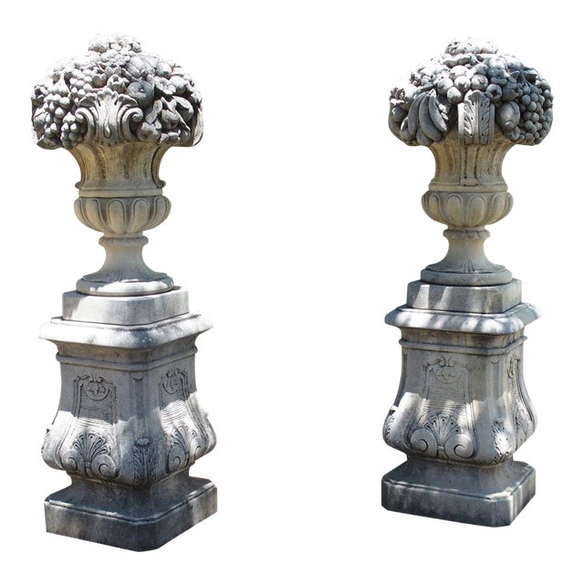 Pair of Italian Limestone Urns With Fruit and Floral Bouquets on Pedestals For Sale
