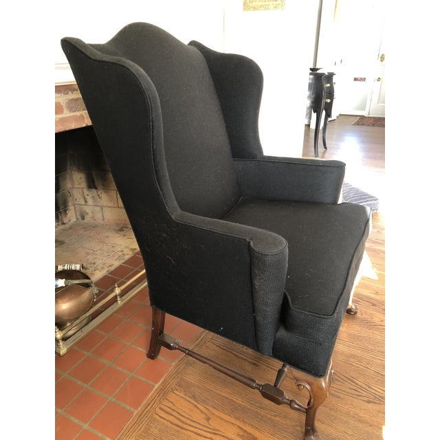 Vintage frame wing chair rebuilt with new upholstery (crypton) in black.