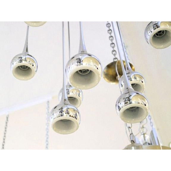 Esperia signed 9 chrome fluted lamps, mid century modern chandelier or flush mount. Each chrome fluted light has a white...