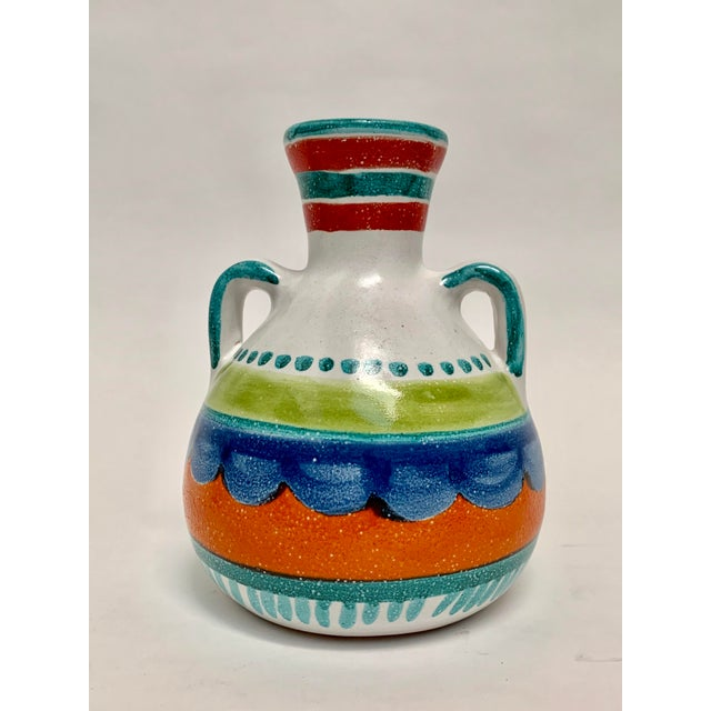 This ca. 1980s vase by Italian artist Giovanni De Simone's is decorated in his iconic primitive style with simple colorful...