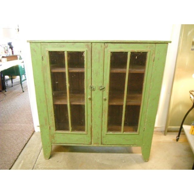 This beautiful antique rustic green pie safe will create a focal point in any room. The patina is wonderful and really...