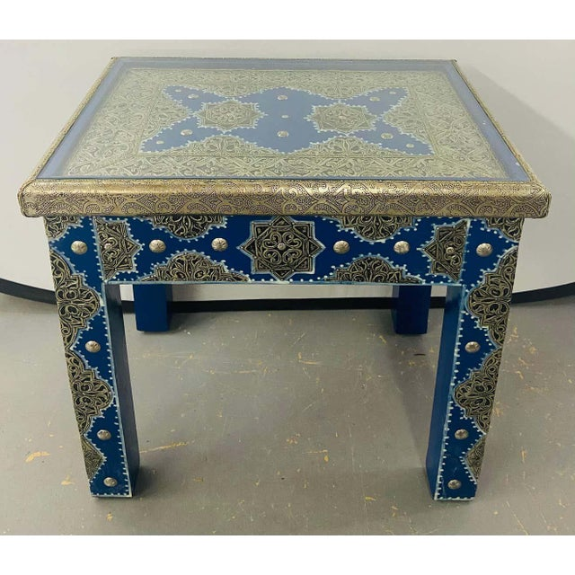 An exceptional pair of Hollywood Regency style Moroccan white brass inlaid wood end or side tables in blue Majorelle....