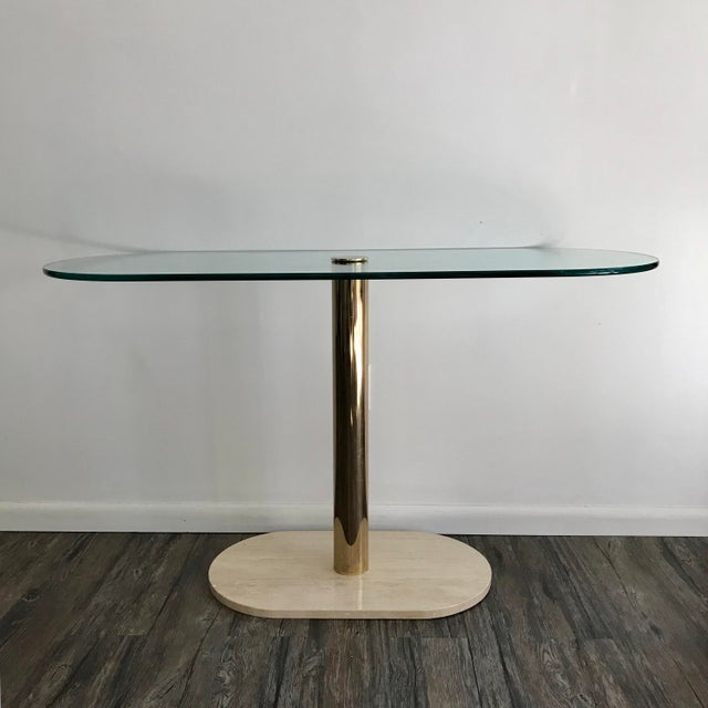 "Console table made by Pace Collection, circa 1970s. This table consists of polished brass base with a 1/2"" thick glass..."