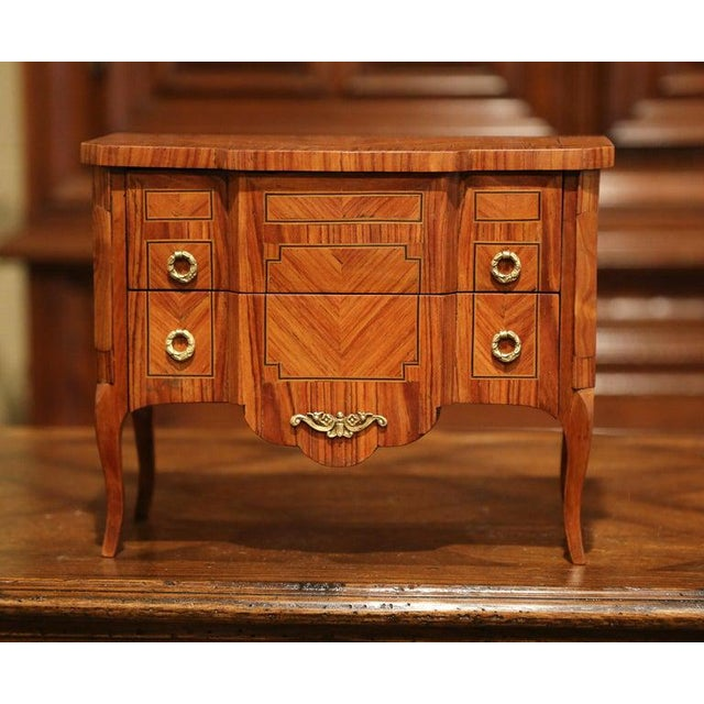 Decorate a master bathroom counter with this miniature chest of drawers. Crafted in France circa, 1960, the petite...