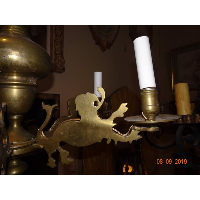 19th Century Belgium brass chandelier with lion motif on the arms. 6 lights. US wired.