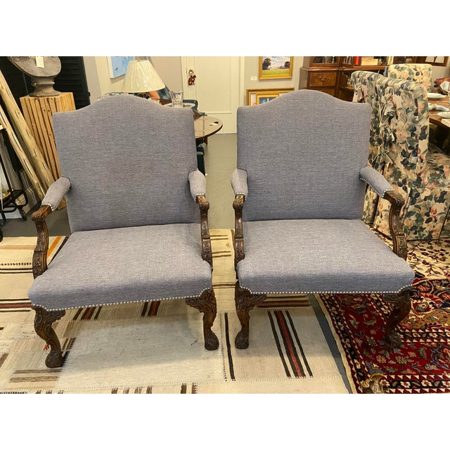These are a gorgeous pair of newly reupholstered chairs. The fabric is a French linen. They are mahogany with silver studs...