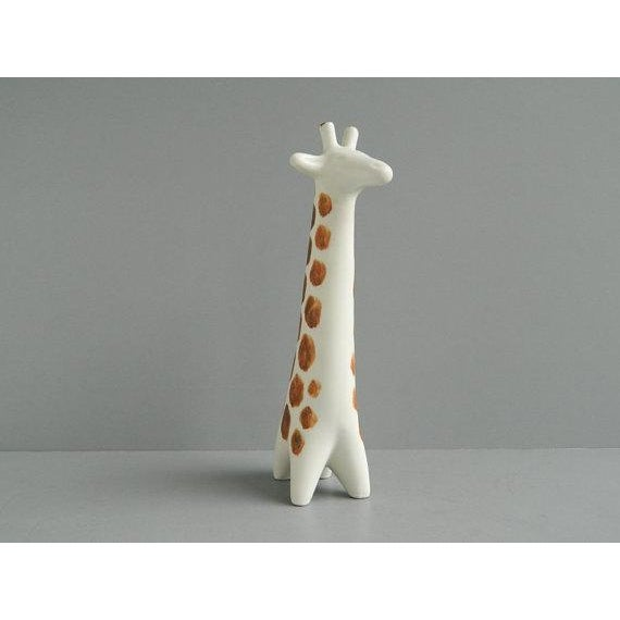 Modern, sleek and adorable giraffe figurine designed by Taisto Kaasinen for Arabia Finland ca. 1964. It measures about 10...