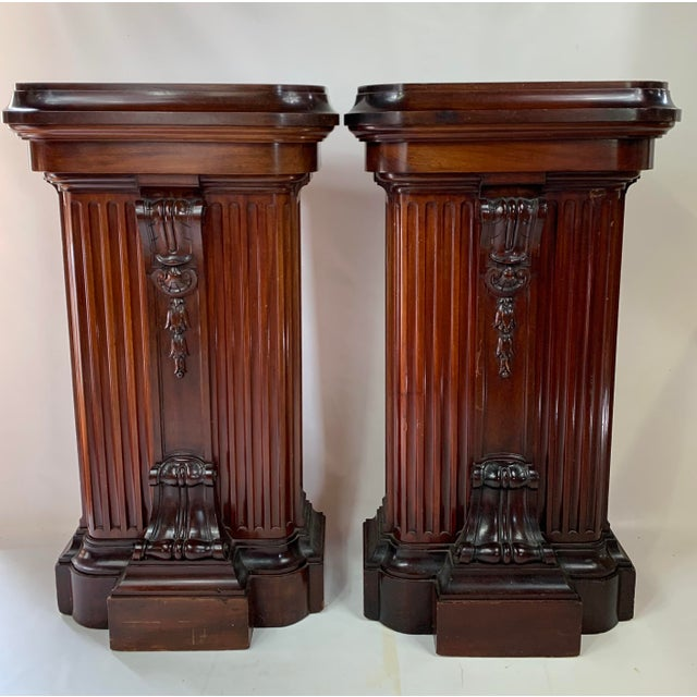 1870s heavy Victorian carved mahogany pedestal. Absolutely gorgeous heavy mahogany carved pedestals. Two available for...
