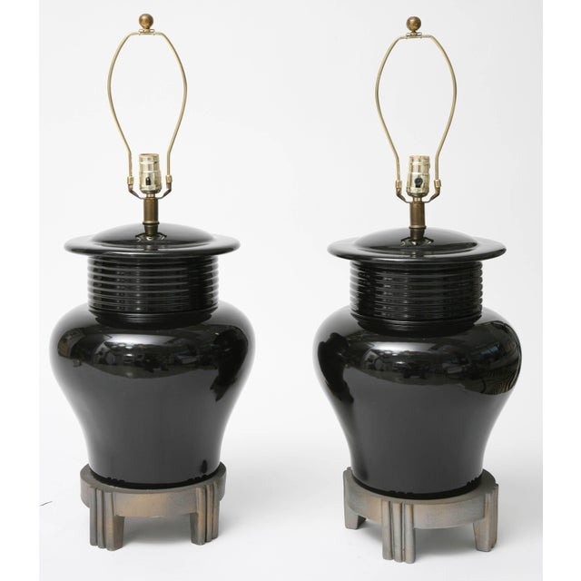 This handsome pair of table lamps are in the Art Deco taste with Asian influence in their form and size. The vase form is...