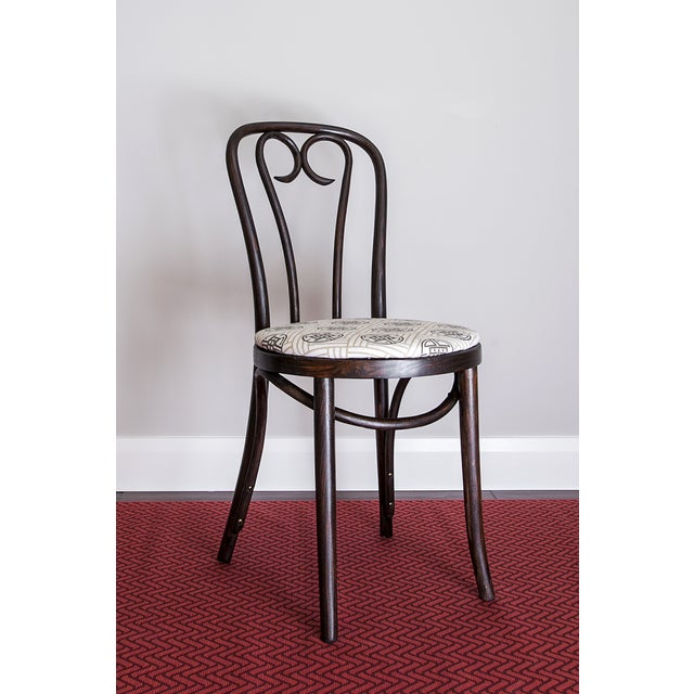 The classic 'candy cane' version of Thonet's great bentwood chairs that revolutionized cafe seating in the 1850s. This...