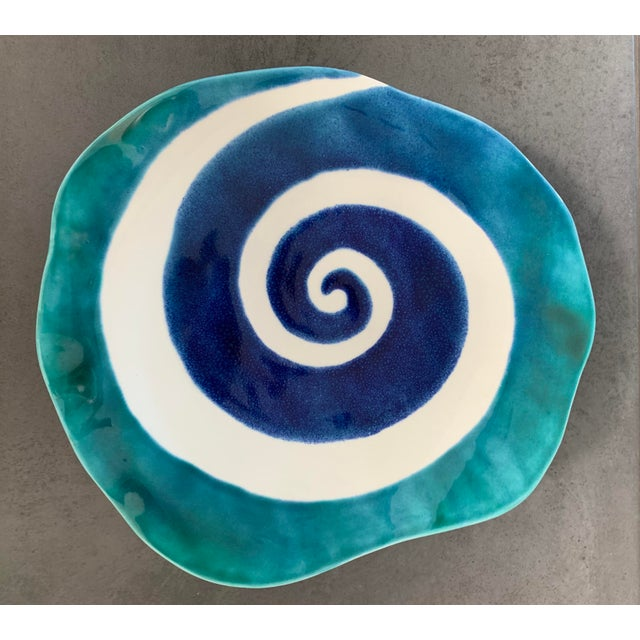 The vibrant shades of blues, teals and metallic accents in this hand painted and handmade large platter are stunning! The...