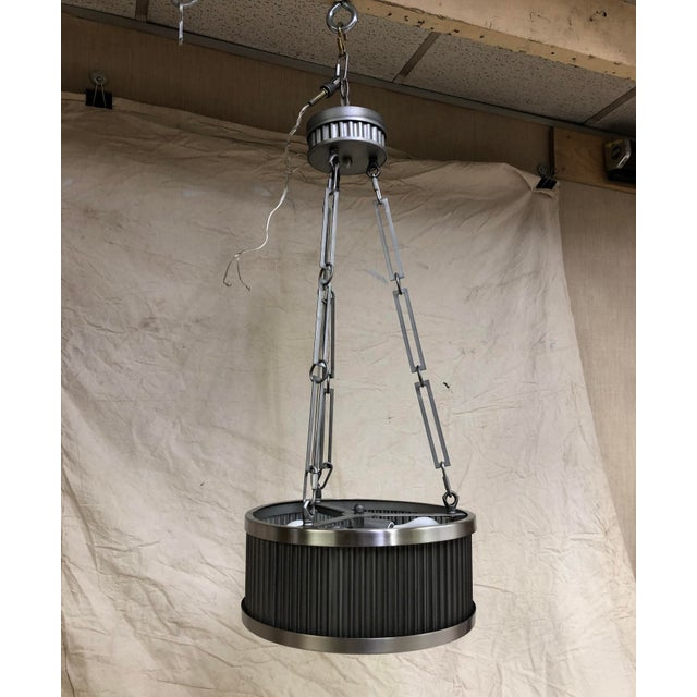 Metal Ruffle 3-Light Pendant by Maxim Ribbed steel drum 3-light pendant. Weathered Zinc with Matte Satin Nickel offers an...