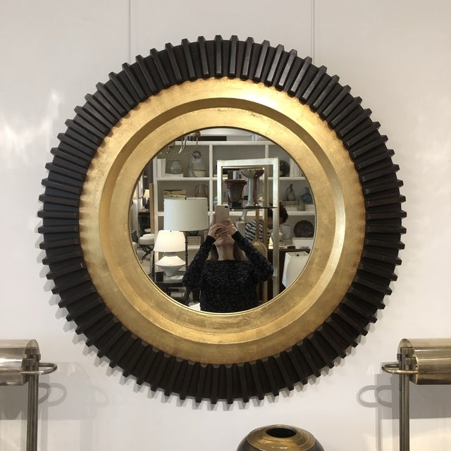 "Circular black and gold gilt wood wall mirror. France, circa 1970. Size: 38"" Diameter"