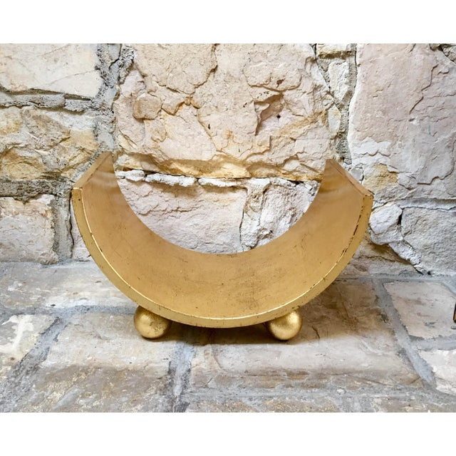 Add a touch of glamour to your space with this Mid Century Italian curved gold wood storage rack with ball feet. Works...