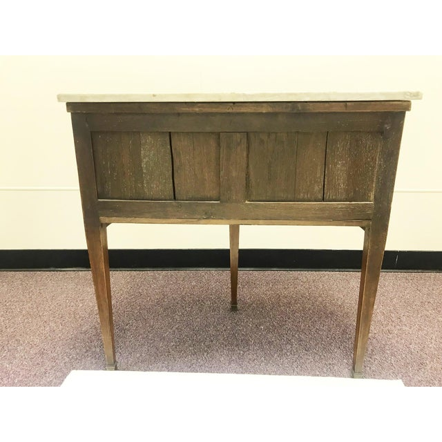 Interesting demi style table. Vintage French walnut with a solid marble top in white with grey veining. The accordion...