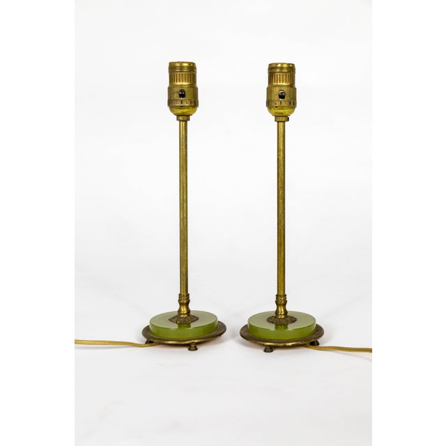 A petite pair of dressing table lamps with amazing, cast brass foliate details and feet. With beautiful, peridot green...