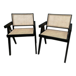 Pierre Jeannerer Inspired Black and Rattan V-Leg Arm Chairs - Pair For Sale