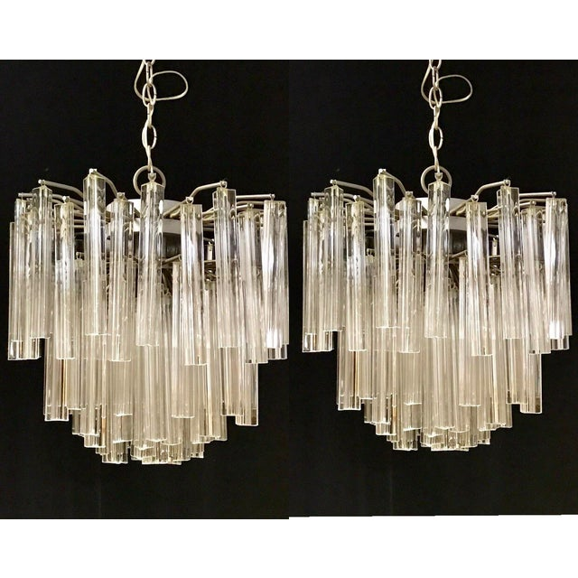 Breath taking pair of Venini chandeliers! From the 1960s/70s. They are both complete; no missing pieces. Each crystal...