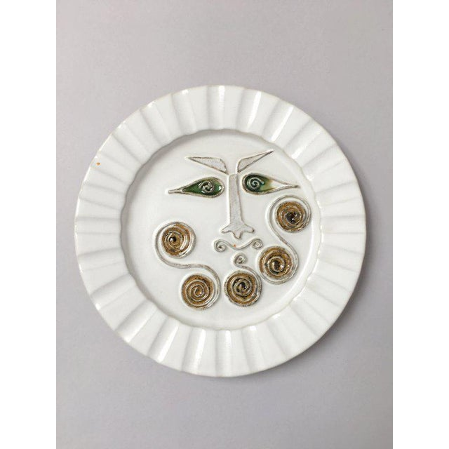 One of a series of decorative plates designed by David Gil and other potters at Bennington Potters in the 60s, these...