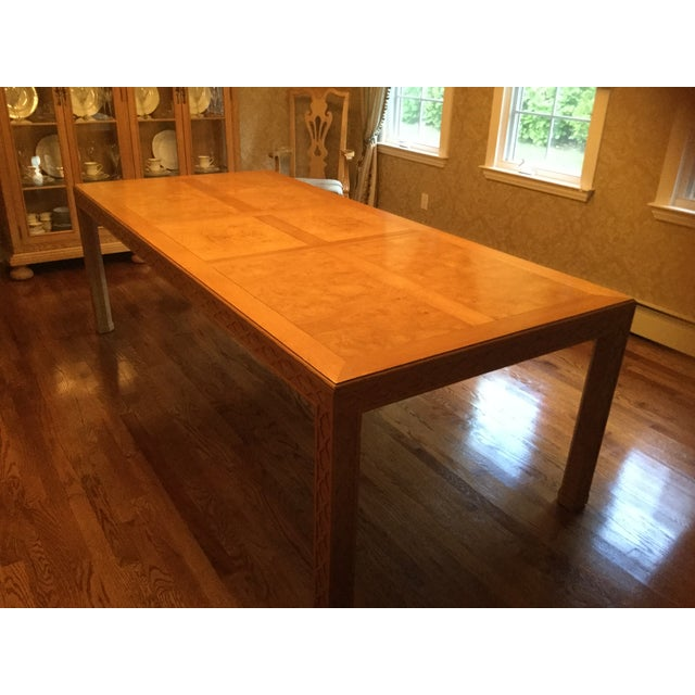 This high end Henredon dining table is from the Bantry Bay Collection. It is made from oak and has inlays of burl in a...