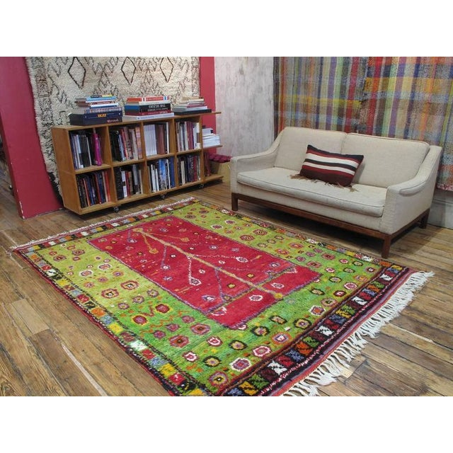 """A very charming village rug from Western Turkey, woven in the shaggy """"Tulu"""" style, featuring a highly stylized and festive..."""