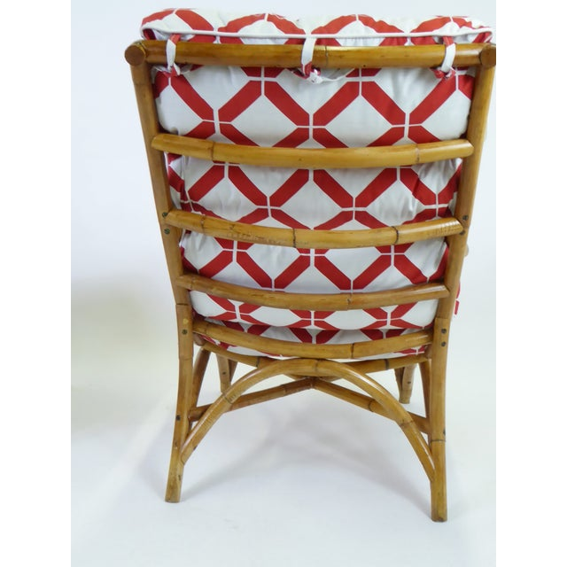High style 1940s rattan lounge chair and ottoman with new lattice motif fabric cushion upholstery with ties. The two-piece...