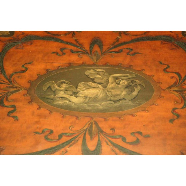 A good quality oval center table in satinwood, Edwardian period, painted and decorated in the manner of Angelica...
