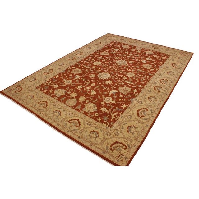 A Persian influenced Turkish hand knotted rug made by skilled artisans capable of creating the most exceptional vegetable...