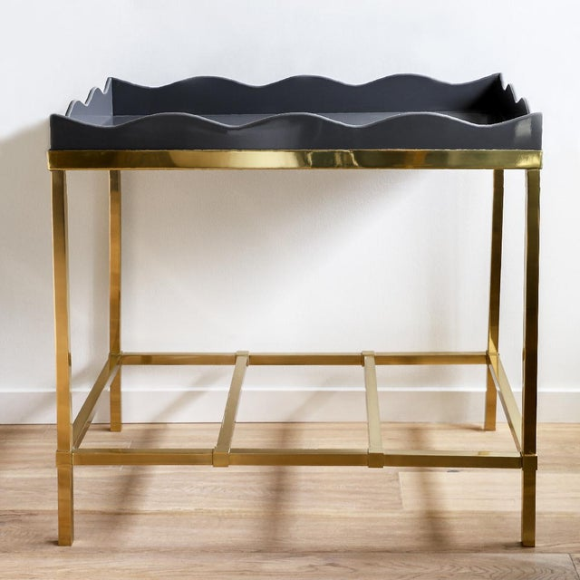 Scalloped top bar table in elephant gray high-gloss lacquer with brass base. Designed by Rita Konig for The Lacquer Company.