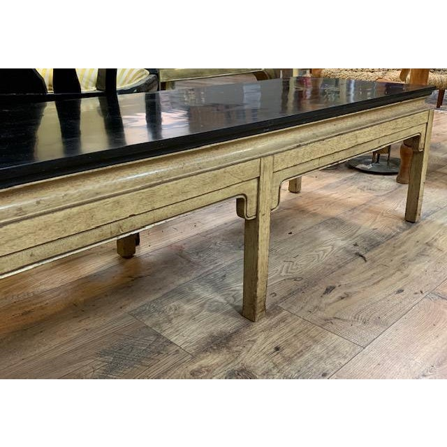 A mid century, Hollywood Regency bench which could also serve as a narrow coffee table. Asian inspired carved wood in a...