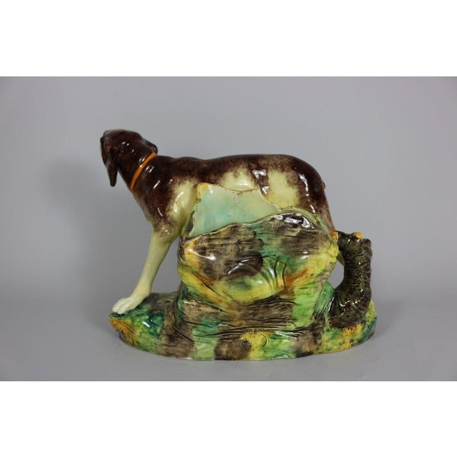 Jerome Massier Fils French Majolica vase figural which features a hunting dog stood in front of a tree trunk. Colouration:...