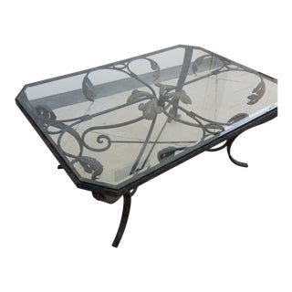 Scrolling Iron and Glass Coffee Table For Sale