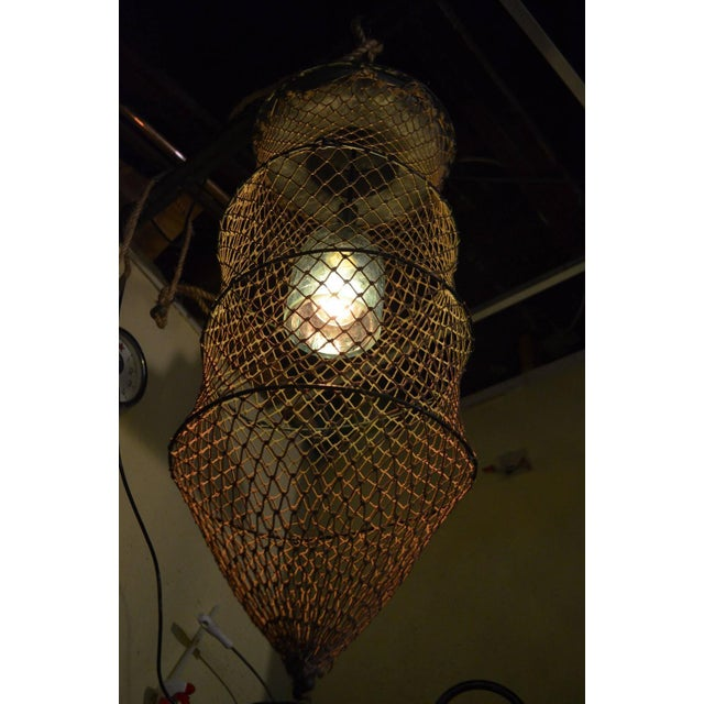 Pendant Light From Seltzer Bottle Inside Fish Trap - Image 7 of 10