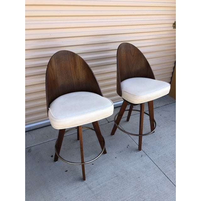 Gorgeous mid-century Chet Beardsley classic bar stools in great shape especially for the era. White vinyl and bent plywood...