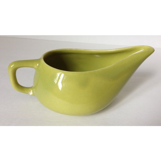 A vintage, 1950s, Mid Century Modern, Chartreuse, Bauer Brusche pottery creamer. 1 small chip on bottom of handle chips,...