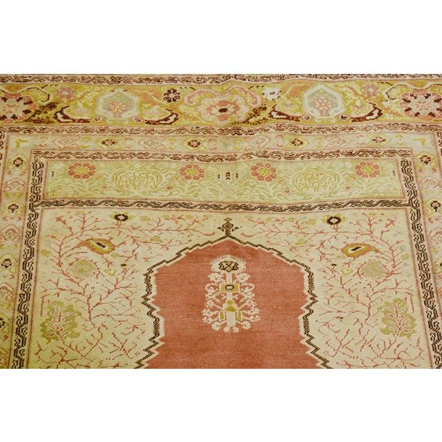 Vintage Turkish hand knotted rug with natural colors and fine weave.