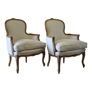20th Century Antique Carved & Upholstered Louis XV Style Bergere Chairs - A Pair For Sale