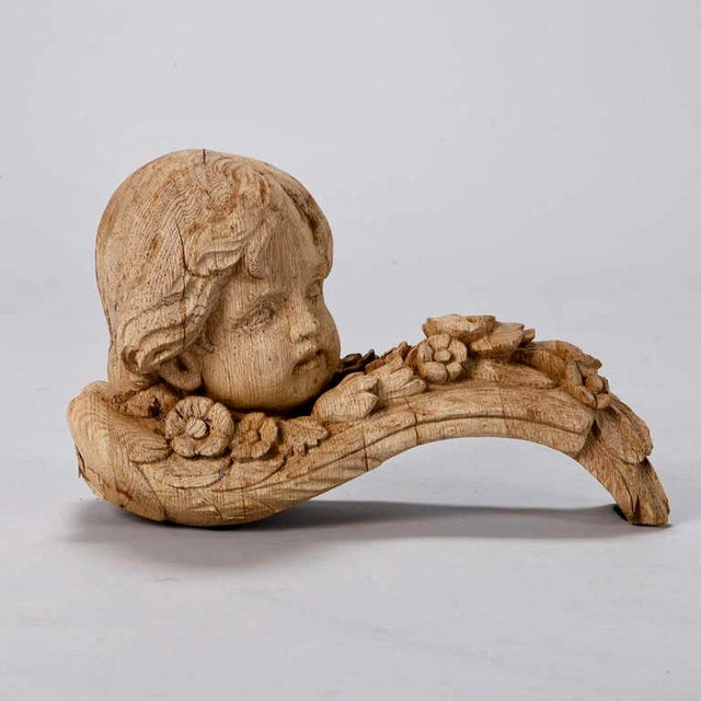 Circa 1880s pair of French bleached oak architectural elements with beautifully carved cherub heads. Sold and priced as a...