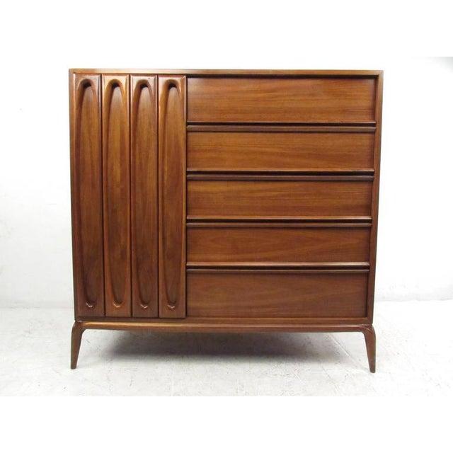 This unique American walnut dresser features stunning vintage craftsmanship, evident in it's simple yet elegant details....