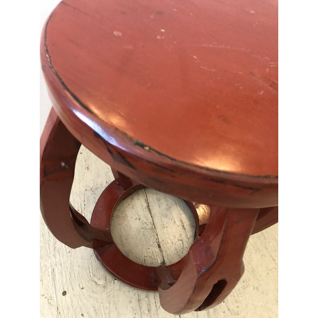 """Beautiful carved wood round drum shaped Chinese garden seat drinks table painted a spicy cinnabar red. Top is 13"""" diameter."""